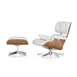 Lounge chair and otoman light by Charles Eames